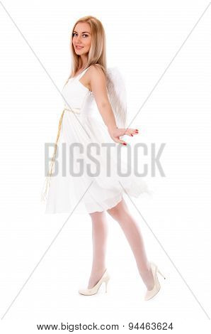 Beautiful Young Woman In A White Dress With Angel Wings