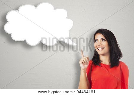 Happy Woman Pointing At Cloud Bubble