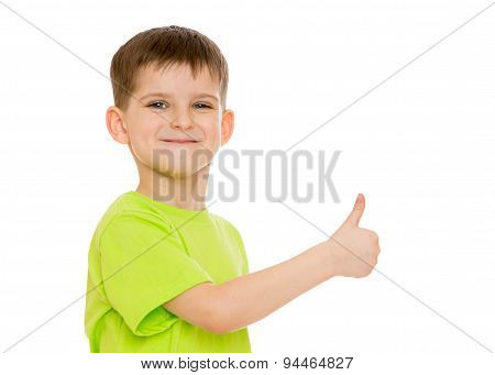 Boy smiling making the hand gesture moves or hitchhiking