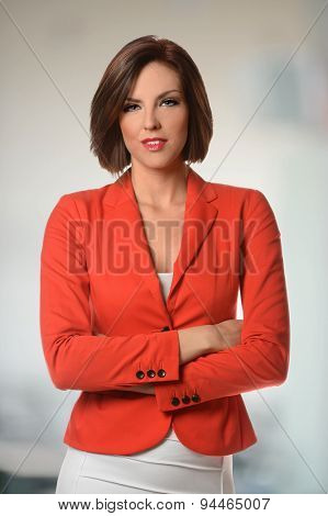 Portrait of young businesswoman with arms crossed inside office environment