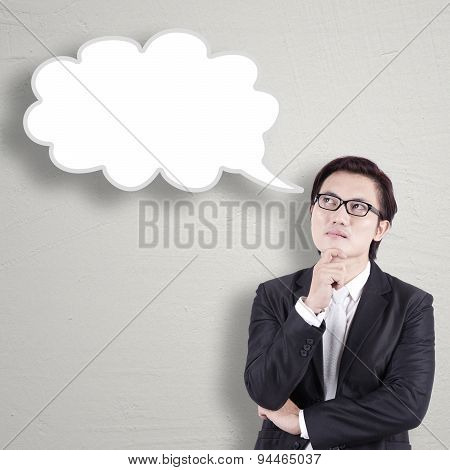 Male Entrepreneur Looking Up At Empty Bubble