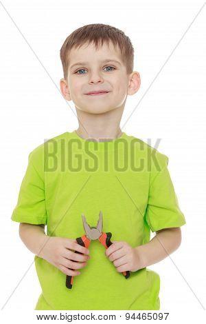 Little boy green t-shirt holding a pair of pliers