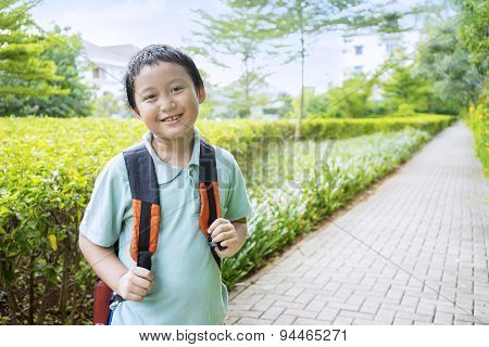 Male Student Standing On The Park