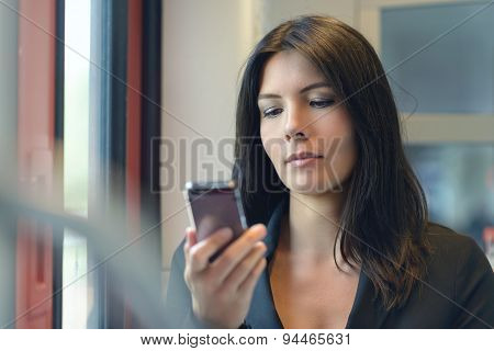 Woman Reading A Text Message On Her Mobile