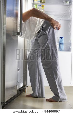 Man Raiding The Fridge At Night