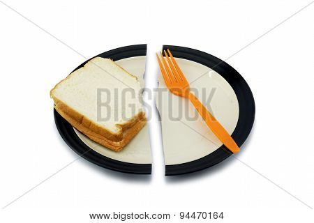 Sandwich Bread And A Fork On A Broken Plate For Diet Concept.