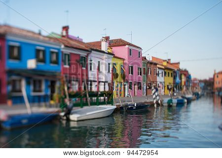 .tilt Shift Photo In Street Of Burano Island With Boats. Soft Focus.