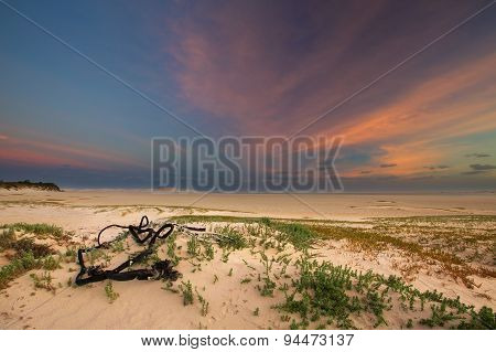 Cloudy Sunrise Over A Quiet Lagoon With Cloud Patterns And Orange Glow