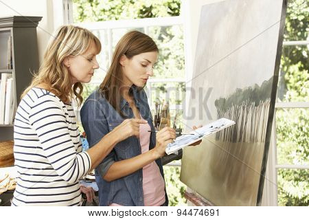 Female Artist Teaching Pupil In Studio