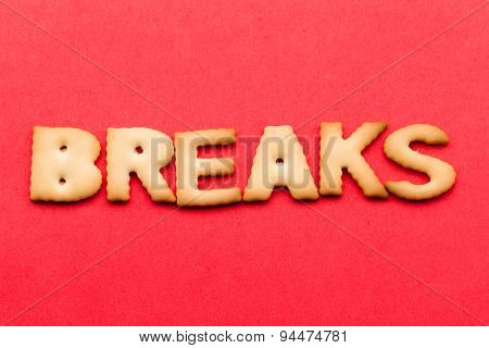 Word breaks biscuit over the red background