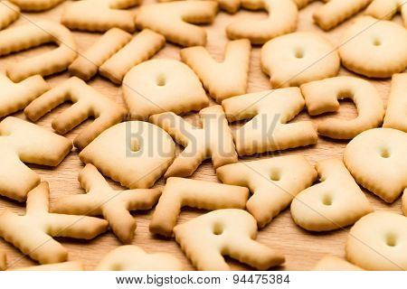 Baked text biscuit over the wooden table