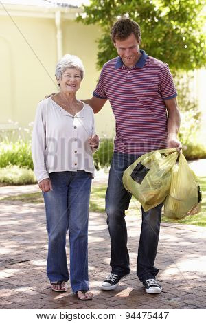 Man Helping Senior Woman With Shopping