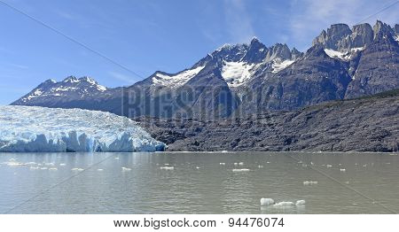 Alpine Glacier And Its Surrounding Mountains