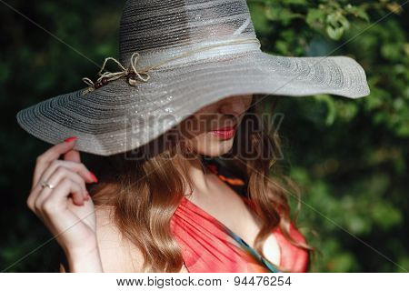 girl in a hat and red dress