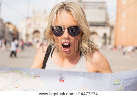 Surprised woman looking at map