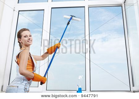 Nice Girl Washing A Window