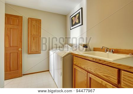 Classic Laundry Room With Tile Floor.