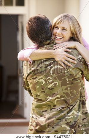 Soldier Returning Home And Greeted By Wife