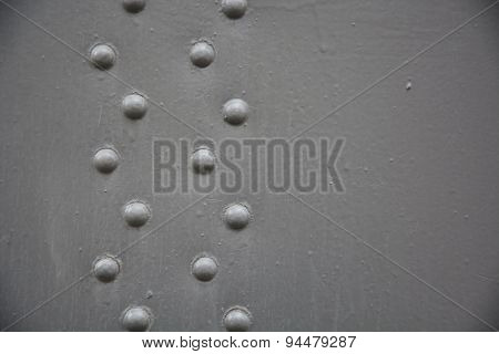 Grey Metal Background With Rivets. Closeup View