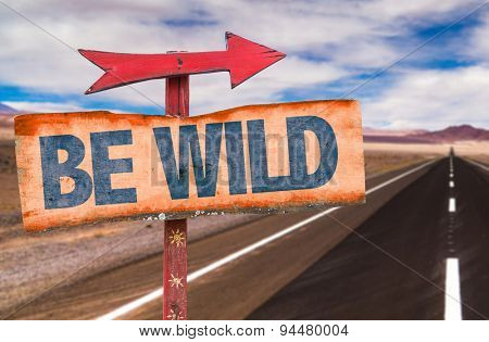 Be Wild sign with road background