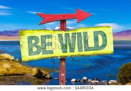 Be Wild sign with landscape background