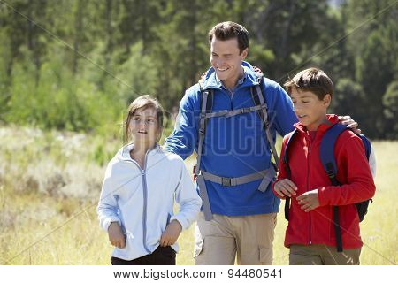 Father With Children On Hike In Beautiful Countryside