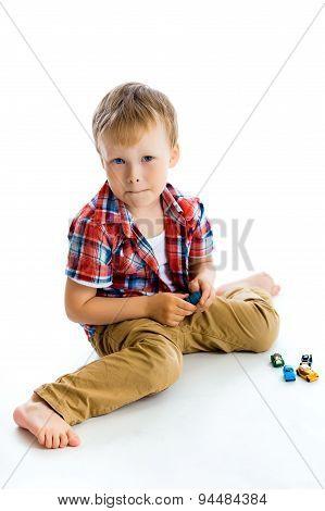 Funny Blue-eyed Three-year Boy. Studio Photo