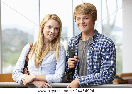 Teenage student girl and boy indoors