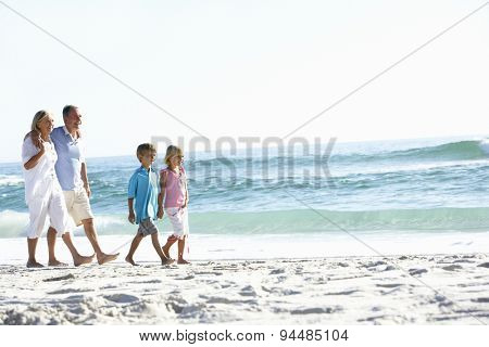 Grandparents and Grandchildren Walking Along Beach