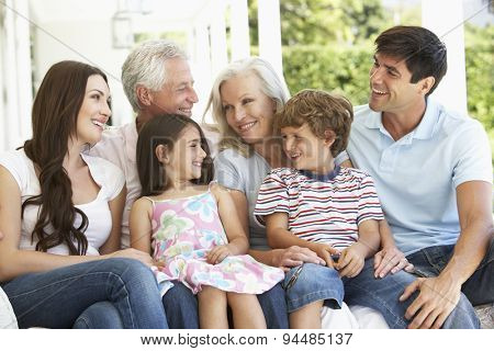 Extendend family sitting in Garden