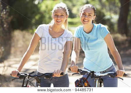Two Young Women On Cycle Ride Together