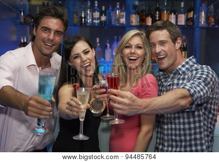Group Of Young Friends Enjoying Drink In Bar