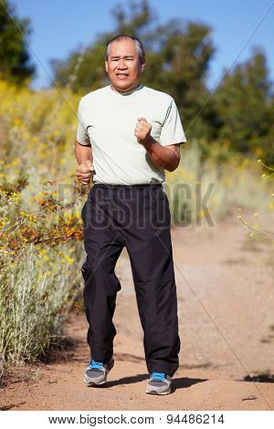 Senior man jogging