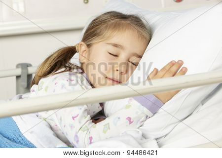 Young girl asleep in hospital bed