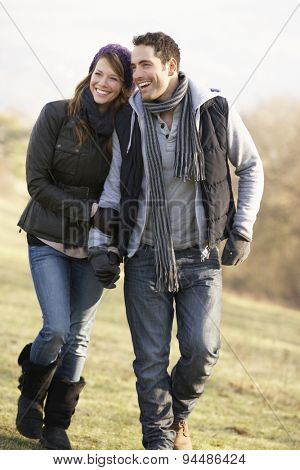 Couple on romantic country walk in winter