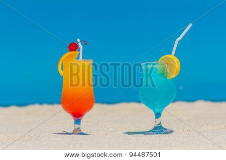 Summer drinks cocktails with blur beach on background
