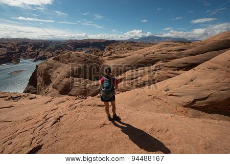 Hiker Backpacker Looking At Lake Powell