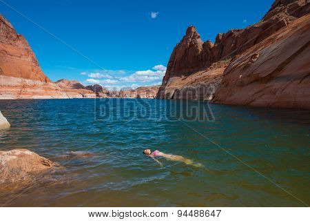 Bikini Woman Taking A Relaxing Bath In The Lake Powell