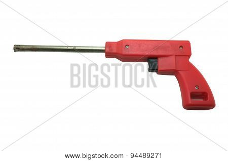 Red gas lighter in shape of gun isolated on white background
