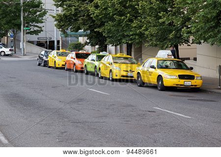 SEATTLE, WA - JUNE 24, 2015: Line of Taxi Cabs outside a hotel in Seattle WA
