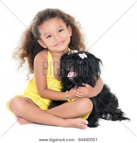Small hispanic girl hugging her adorable pet dog isolated on white