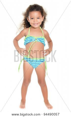 Cute small hispanic girl wearing a swimsuit isolated on white