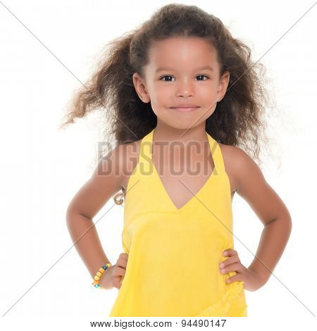 Cute small african-american or hispanic girl wearing a yellow summer dress isolated on white
