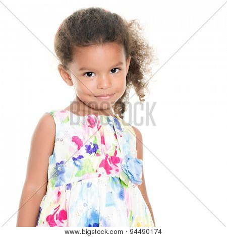 Beautiful small african-american or hispanic girl wearing a flowers summer dress isolated on white