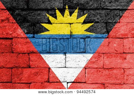 Flag Of Antigua And Barbuda On Old Brick Wall.
