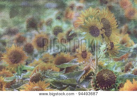 Abstract blurred field of blooming sunflowers on burlap texutured background mad vintage-retro style