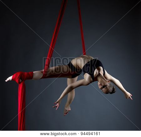 Image of elegant girl doing acrobatic trick