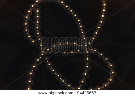 Beautiful Pearl Necklace On A Black Silk