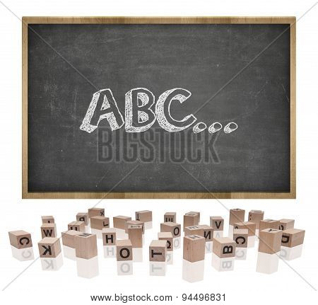 ABC concept on blackboard with wooden frame and block letters