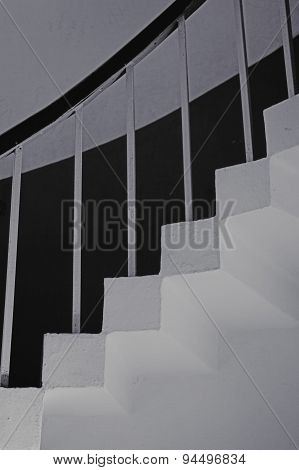 Concrete Stairs With Railings Against The Wall